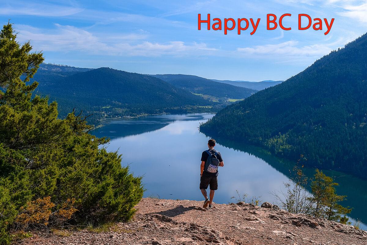 Hiker in BC looking at mountain lake